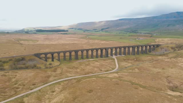 an aerial shot of the ribblehead viaduct in yorkshire dales national park on an overcast day, on may 09 2021, in yorkshire, united kingdom. - overcast stock videos & royalty-free footage