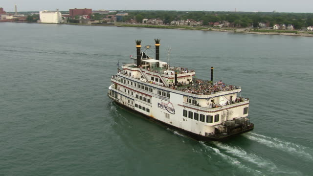 Detroit, Michigan - July 7, 2011: An aerial shot orbits around the Detroit Princess Riverboat as it cruises on the Detroit River.