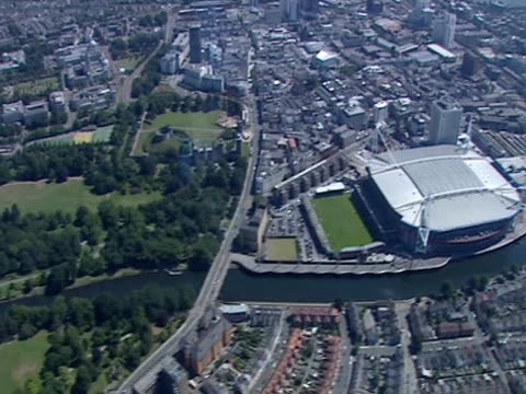 an aerial shot over the centre of cardiff. - cardiff wales stock videos & royalty-free footage