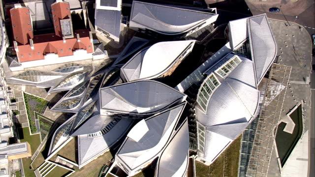 an aerial shot over the scottish parliament building. available in hd. - holyrood bildbanksvideor och videomaterial från bakom kulisserna