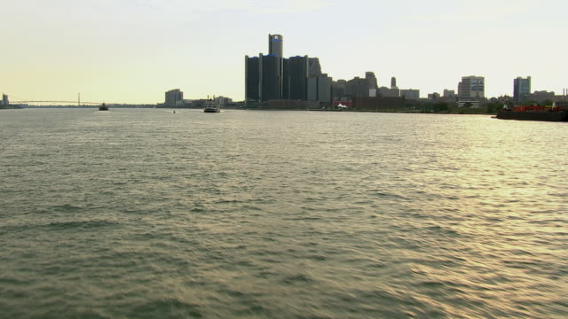 Detroit, Michigan - July 7, 2011: An aerial shot pushing in over the Detroit River and tracking the Detroit Riverboat Princess as it carries guests on a river cruise.