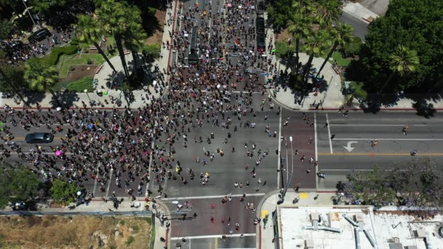 an aerial view as people march during the all black lives matter solidarity march, replacing the annual gay pride celebration, as protests continue... - west hollywood stock-videos und b-roll-filmmaterial