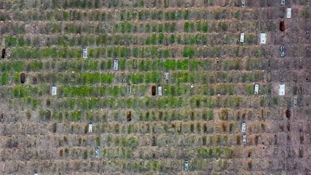 an aerial view at caju cemetery with graves continuing to be dug on march 24, 2021 in rio de janeiro, brazil. one day after registering over 3,000... - brazil stock videos & royalty-free footage