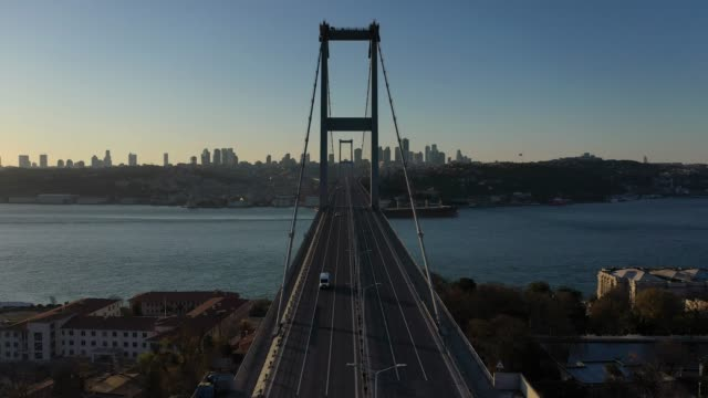an aerial view from a drone shows a small number of cars cross a near empty july 15 martyrs' bridge, during a two-day lockdown imposed to prevent the... - istanbul stock videos & royalty-free footage