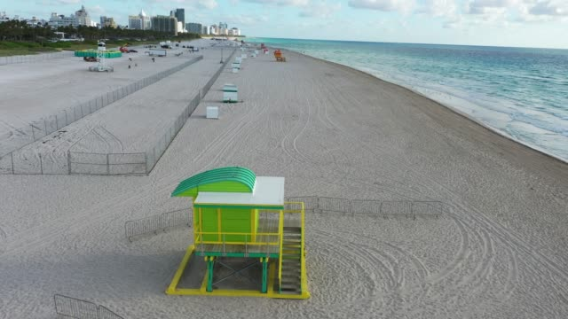 an aerial view from a drone shows an area of south beach that the city closed in an effort to prevent the spread of the coronavirus on march 16, 2020... - サウスビーチ点の映像素材/bロール