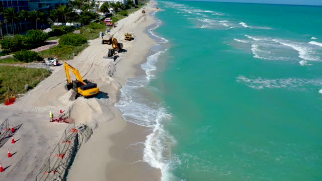 an aerial view from a drone shows as construction work by the u.s. army corps of engineers distributes sand along the beach on january 14, 2020 in... - sand stock videos & royalty-free footage