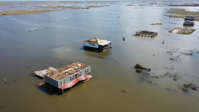 vidéos et rushes de an aerial view from a drone shows damaged homes surrounded by water after hurricane laura passed through the area on august 29, 2020 in little... - gulf coast states