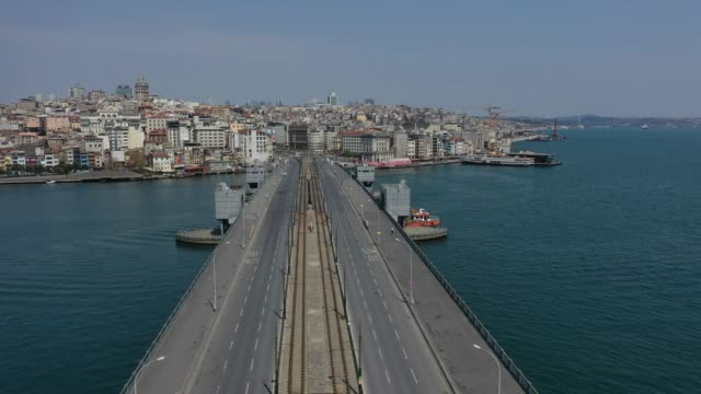 an aerial view from a drone shows galata bridge empty during a twoday lockdown imposed to prevent the spread of coronavirus on april 11 2020 in... - istanbul stock videos & royalty-free footage
