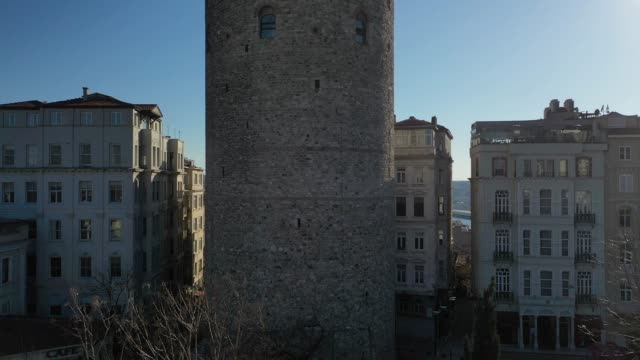 an aerial view from a drone shows galata tower and surrounds empty during a two-day lockdown imposed prevent the spread of coronavirus on april 12,... - galataturm stock-videos und b-roll-filmmaterial