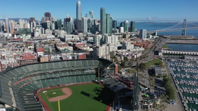 an aerial view from a drone shows oracle park home of the san francisco giants empty on opening day march 26 2020 in san francisco california major... - san francisco california stock videos & royalty-free footage