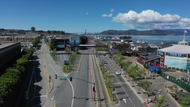 an aerial view from a drone shows streets virtually deserted at the pier 39 tourist destination on march 26 2020 in san francisco california with... - san francisco california stock videos & royalty-free footage