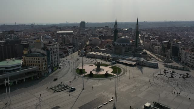 an aerial view from a drone shows taksim square and the surrounding area empty during a two-day lockdown imposed to prevent the spread of coronavirus... - istanbul stock-videos und b-roll-filmmaterial