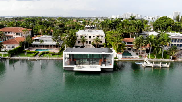 an aerial view from a drone shows the arkup houseboat, a green-energy luxury floating home that can allow owners to adapt as the sea level continues... - miami beach stock videos & royalty-free footage