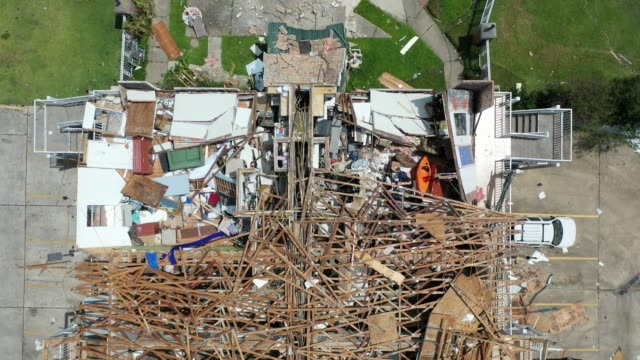 an aerial view from a drone shows the damage caused to properties after hurricane laura passed through the area on august 28, 2020 in lake charles,... - louisiana stock videos & royalty-free footage