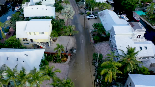 an aerial view from a drone shows the ocean water that inundates a part of a street on october 22, 2019 in key largo, florida. the water flooded the... - tide stock videos & royalty-free footage