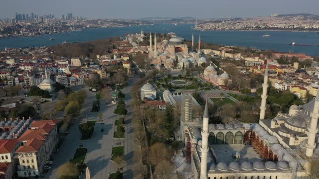 an aerial view from a drone shows the old city's monuments blue mosque and hagia sophia and the surrounding area empty during a twoday lockdown... - blue mosque stock videos & royalty-free footage