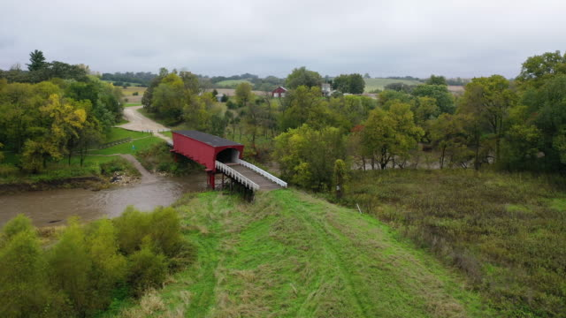 an aerial view from a drone shows the roseman covered bridge that was built in 1883 on october 10 2019 in winterset iowa  the 2020 iowa democratic... - bridge built structure stock videos & royalty-free footage