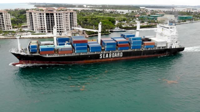 an aerial view from a drone shows the seaboard marine cargo ship leaving portmiami on the day that the bureau of economic analysis announced that the... - baia di biscayne video stock e b–roll