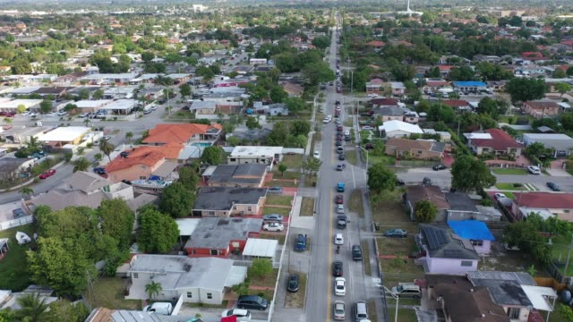 an aerial view from a drone shows vehicles lining up to receive unemployment applications being given out by city of hialeah employees in front of... - florida us state stock videos & royalty-free footage