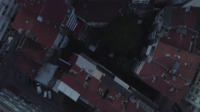 an aerial view looking down on the kadikoy rooftops tilting up to see the sunset. istanbul. turkey. - イスタンブール 金角湾点の映像素材/bロール
