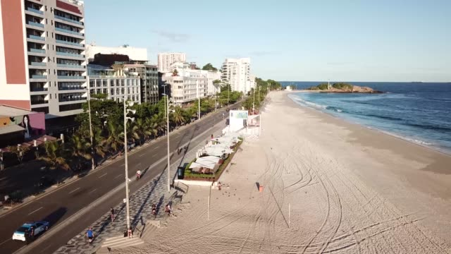 an aerial view of a near empty ipanema beach on march 26, 2020 in rio de janeiro, brazil. according to the ministry of health, as of today, brazil... - rio de janeiro stock videos & royalty-free footage