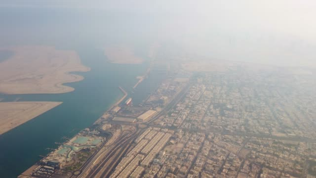 an aerial view of a packed city full with low rise buildings and ports. - basra stock-videos und b-roll-filmmaterial