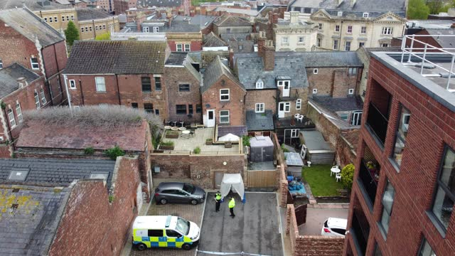 an aerial view of a police tent at the rear of the clean plate cafe on southgate street on may 11, 2021 in gloucester, england. police search for... - real time stock videos & royalty-free footage