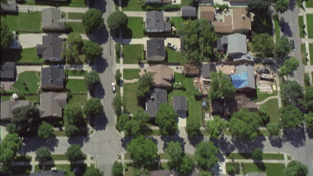 an aerial view of a residential suburban area. - suburban stock videos & royalty-free footage