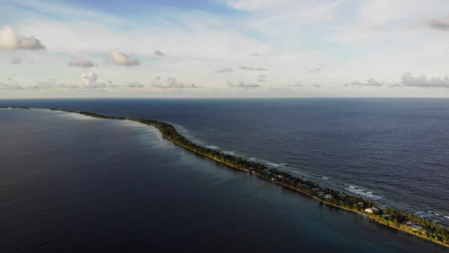 an aerial view of a strip of land between the pacific ocean and lagoon on november 28. the low-lying south pacific island nation of tuvalu holds... - south pacific ocean点の映像素材/bロール