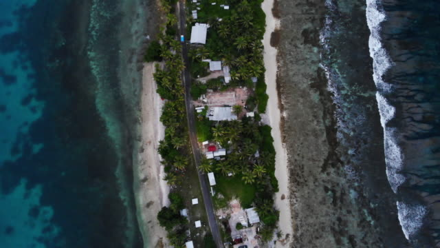 an aerial view of a strip of land on november 24 in funafuti, tuvalu. the low-lying south pacific island nation of tuvalu holds about 11,000 people... - pacific islands stock videos & royalty-free footage