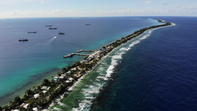 an aerial view of a strip of land on november 28 in funafuti tuvalu the lowlying south pacific island nation of tuvalu holds about 11000 people and... - pazifikinseln stock-videos und b-roll-filmmaterial