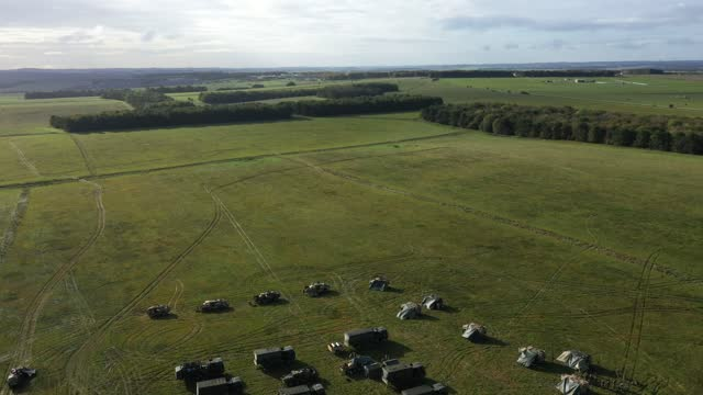 "vidéos et rushes de an aerial view of a uk task group's temporary camp within an encircling barricade of wagons, or ""laager"", during a mission rehearsal exercise ahead... - british military"