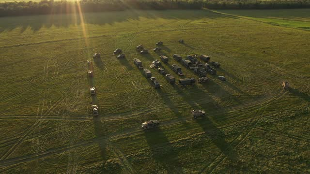 """an aerial view of a uk task group's temporary camp within an encircling barricade of wagons, or """"laager"""", during a mission rehearsal exercise ahead... - temporary stock videos & royalty-free footage"""
