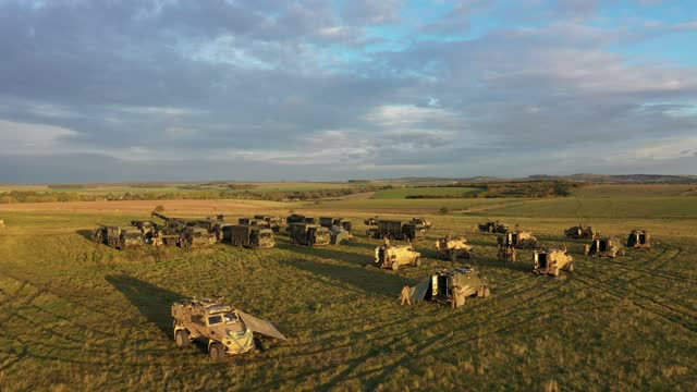 """an aerial view of a uk task group's temporary camp within an encircling barricade of wagons, or """"laager"""", during a mission rehearsal exercise ahead... - ウィルトシャー州点の映像素材/bロール"""