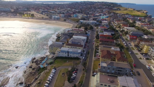 an aerial view of beach side homes in bondi beach - oceanside stock videos and b-roll footage