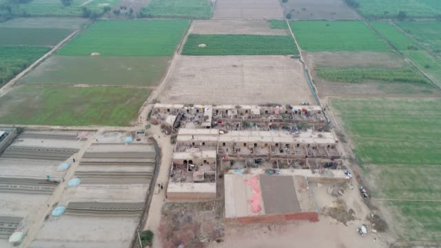 an aerial view of brick making factory, plowed fields and agricultural land through drone - punjab pakistan stock videos and b-roll footage