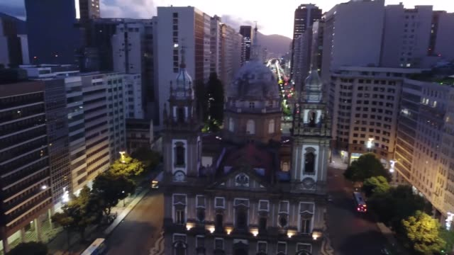 an aerial view of candelaria church and a near empty presidente vargas avenue on march 26, 2020 in rio de janeiro, brazil. according to the ministry... - rio de janeiro stock videos & royalty-free footage