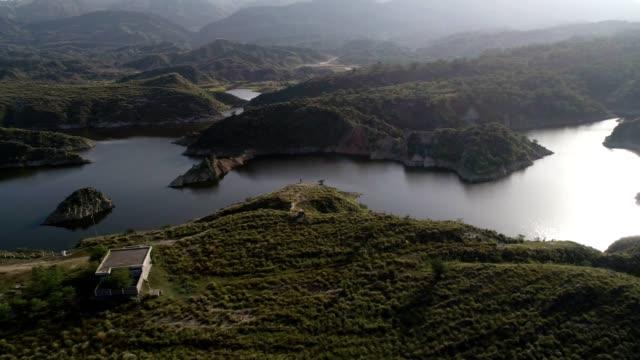 vídeos y material grabado en eventos de stock de an aerial view of choi dam from drone - panyab pakistán