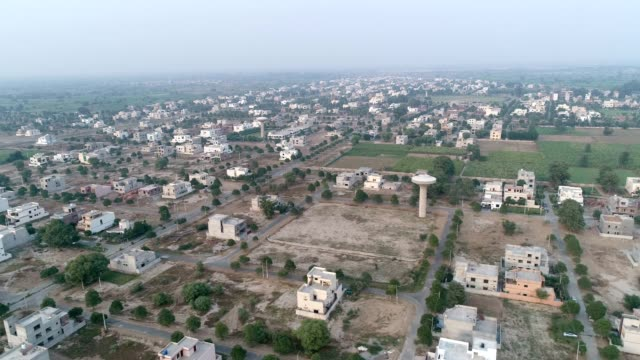 an aerial view of city through drone - punjab pakistan stock videos & royalty-free footage