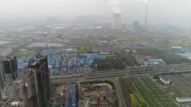 An aerial view of construction site and thermal power plant on March 23 2017 in Hefei China
