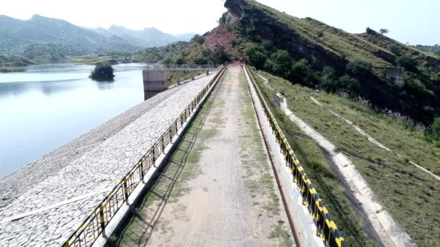 an aerial view of dam dhok tallian from drone - wasserkraft stock-videos und b-roll-filmmaterial