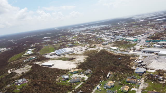 an aerial view of damage caused by hurricane dorian is seen in marsh harbour on great abaco island on september 4, 2019 in great abaco, bahamas. a... - バハマ点の映像素材/bロール