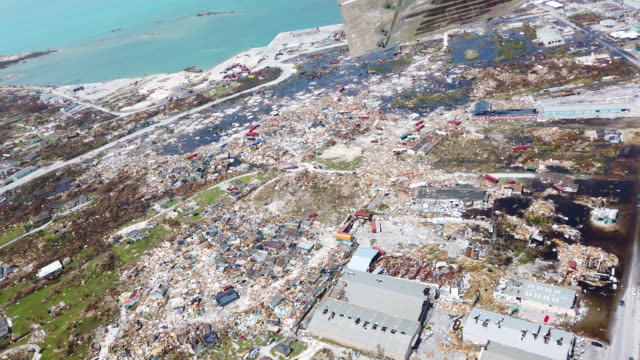 stockvideo's en b-roll-footage met an aerial view of damage caused by hurricane dorian is seen in marsh harbour on great abaco island on september 4, 2019 in great abaco, bahamas. a... - beschadigd
