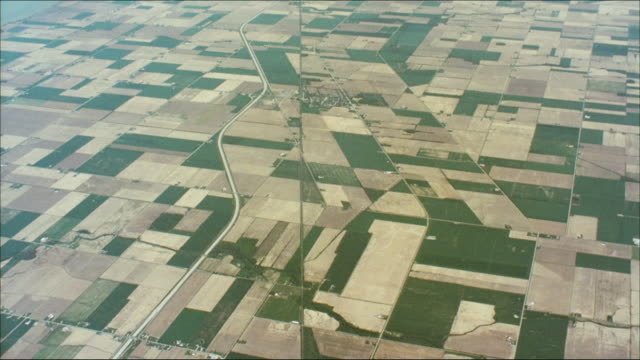 an aerial view of farms near cleveland. - patchwork stock videos & royalty-free footage