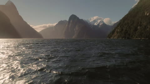 an aerial view of fiordland national park with milford sound waterfall. new zealand. - coastal feature stock videos & royalty-free footage