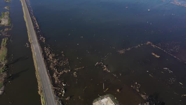 vidéos et rushes de an aerial view of flooding a day after hurricane delta made landfall surrounding structures already destroyed by hurricane laura on october 10, 2020... - gulf coast states