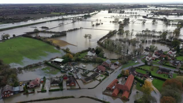 an aerial view of floodwater covering roads and part of local houses in the fishlake area on november 12 2019 in doncaster england more heavy rain is... - yorkshire england stock videos & royalty-free footage