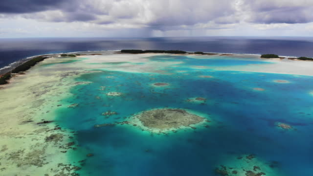 an aerial view of funafuti atoll on november 26, 2019 in funafuti, tuvalu. the low-lying south pacific island nation of tuvalu holds about 11,000... - pacific islands stock videos & royalty-free footage