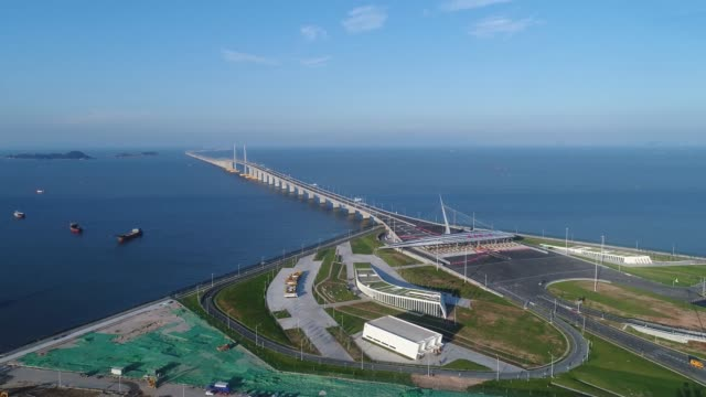an aerial view of hong kongzhuhaimacao bridge on may 19 2018 in zhuhai guangdong province of china the hong kong–zhuhai–macau bridge is a... - bridge built structure stock videos & royalty-free footage