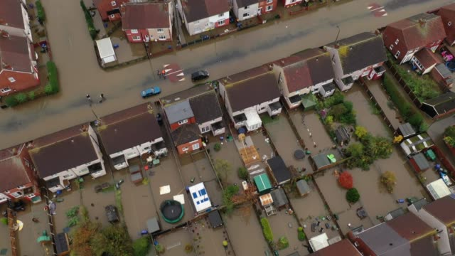 an aerial view of houses and cars submerged under water following severe flooding on november 08 2019 in doncaster united kingdom parts of northern... - flood stock videos & royalty-free footage